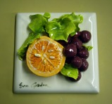 Half Orange with Red Grapes